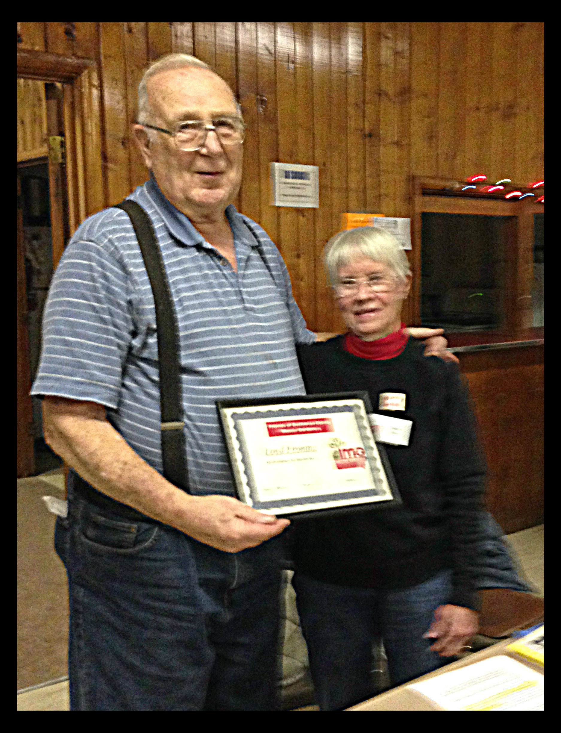 Loyd Froning (1935 - 2014) receiving a Master Gardener volunteer certificate.